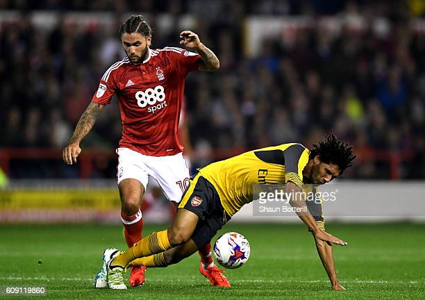 Mohamed Elneny of Arsenal and Henri Lansbury of Nottingham Forest in action during the EFL Cup Third Round match between Nottingham Forest and...
