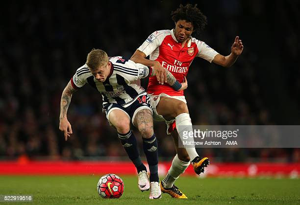 Mohamed Elneny of Arsenal and James McClean of West Bromwich Albion compete during the Barclays Premier League match between Arsenal and West...