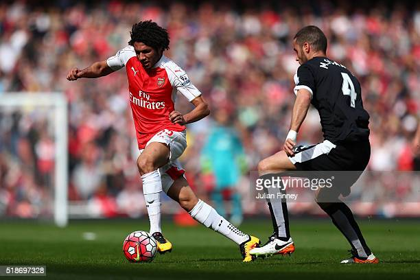 Mohamed Elneny of Arsenal and Mario Suarez of Watford compete for the ball during the Barclays Premier League match between Arsenal and Watford at...