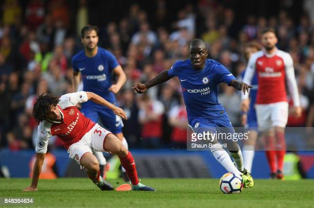 Mohamed Elneny of Arsenal and N'Golo Kante of Chelsea battle for possession during the Premier League match between Chelsea and Arsenal at Stamford...