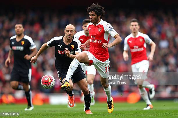 Mohamed Elneny of Arsenal and Nordin Amrabat of Watford compete for the ball during the Barclays Premier League match between Arsenal and Watford at...