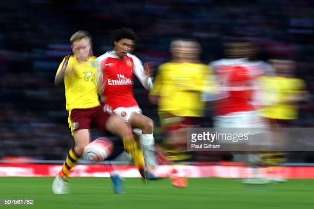 Mohamed Elneny of Arsenal and Scott Arfield of Burnley compete for the ball during the Emirates FA Cup Fourth Round match between Arsenal and Burnley...
