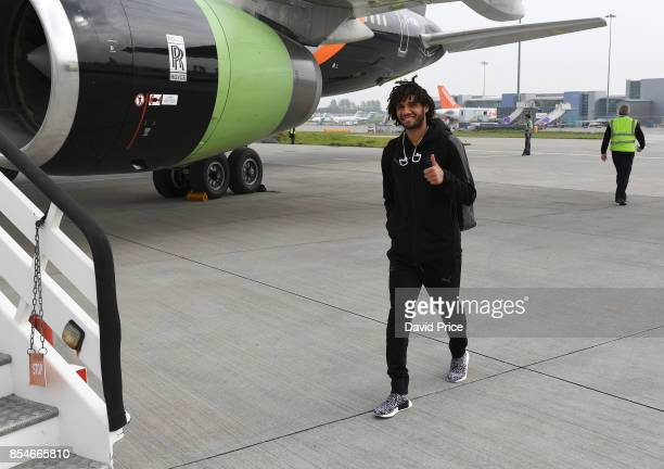 Mohamed Elneny of Arsenal board the plane at Luton Airport on September 27 2017 in Luton England
