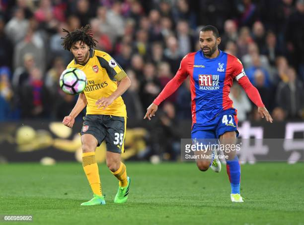 Mohamed Elneny of Arsenal breaks past Jason Puncheon of Crystal Palace during the Premier League match between Crystal Palace and Arsenal at Selhurst...