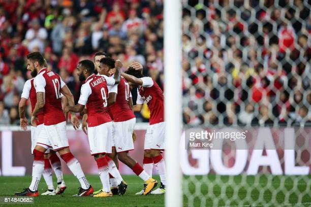 Mohamed Elneny of Arsenal celebrates with team mates after scoring a goal during the match between the Western Sydney Wanderers and Arsenal FC at ANZ...
