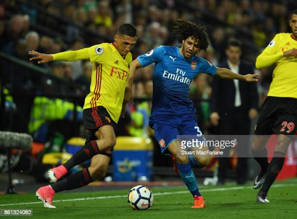 Mohamed Elneny of Arsenal challenged by Jose Holebas of Watford during the Premier League match between Watford and Arsenal at Vicarage Road on...