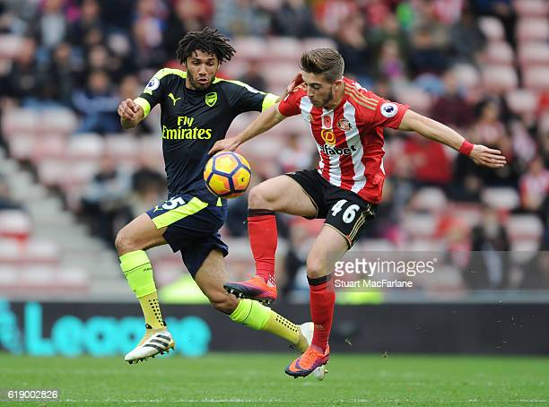 Mohamed Elneny of Arsenal challenged by Lynden Gooch of Sunderland during the Premier League match between Sunderland and Arsenal at Stadium of Light...