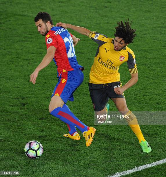 Mohamed Elneny of Arsenal challenges Luka Milivojevic of Palace during the Premier League match between Crystal Palace and Arsenal at Selhurst Park...