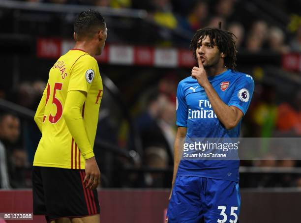 Mohamed Elneny of Arsenal clashes with Watford defender Jose Holebas during the Premier League match between Watford and Arsenal at Vicarage Road on...