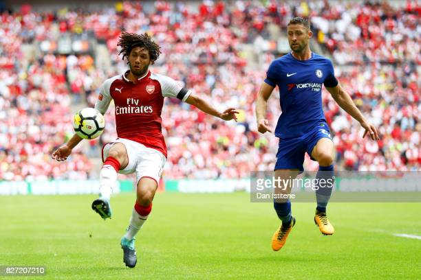 Mohamed Elneny of Arsenal controls the ball under pressure from Gary Cahill of Chelsea during the FA Community Shield match between Chelsea and...