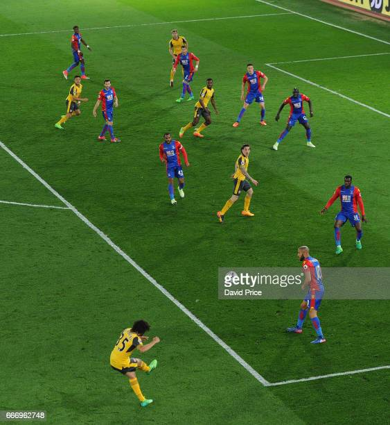Mohamed Elneny of Arsenal crosses the ball into the penalty area during the Premier League match between Crystal Palace and Arsenal at Selhurst Park...