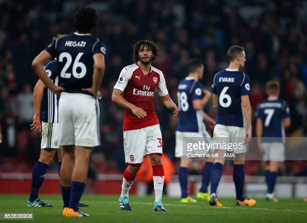 Mohamed Elneny of Arsenal heads towards Ahmed Hegazy of West Bromwich Albion during the Premier League match between Arsenal and West Bromwich Albion...