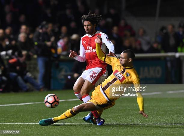 Mohamed Elneny of Arsenal is challenged by Craig Eastmond of Sutton during the Emirates FA Cup Fifth Round match between Sutton United and Arsenal on...