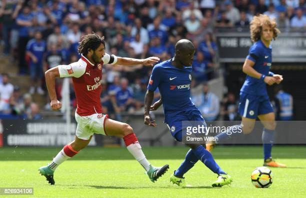 Mohamed Elneny of Arsenal puts pressure on N'Golo Kante of Chelsea during the The FA Community Shield final between Chelsea and Arsenal at Wembley...