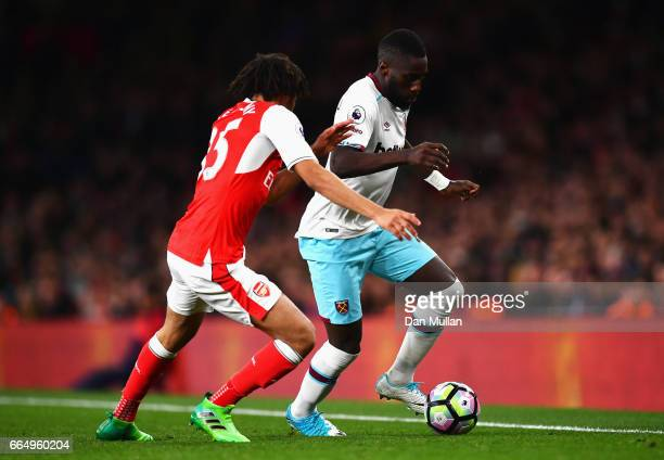 Mohamed Elneny of Arsenal putss pressure on Cheikhou Kouyate of West Ham United during the Premier League match between Arsenal and West Ham United...
