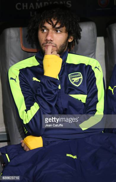 Mohamed Elneny of Arsenal seats on the bench during the UEFA Champions League Round of 16 first leg match between FC Bayern Muenchen and Arsenal FC...