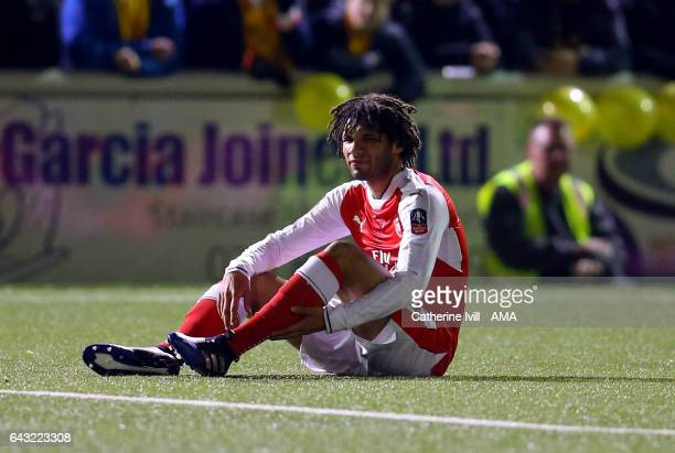Mohamed Elneny of Arsenal sits injured during The Emirates FA Cup Fifth Round match between Sutton United and Arsenal on February 20 2017 in Sutton...
