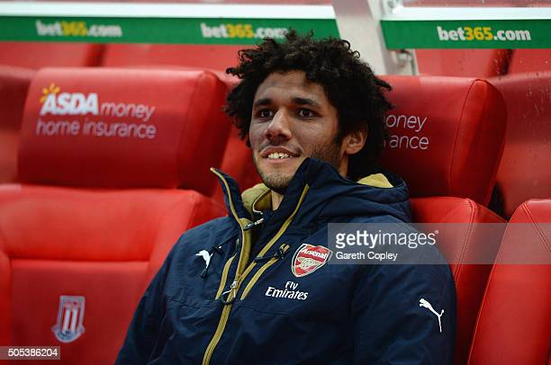 Mohamed Elneny of Arsenal sits on the bench prior to the Barclays Premier League match between Stoke City and Arsenal at Britannia Stadium on January...