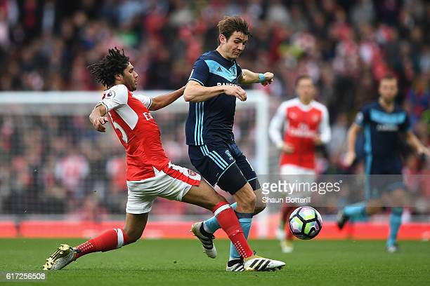 Mohamed Elneny of Arsenal tackles Marten de Roon of Middlesbrough during the Premier League match between Arsenal and Middlesbrough at the Emirates...