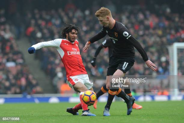Mohamed Elneny of Arsenal tackles Sam Clucas of Hull during the Premier League match between Arsenal and Hull City at Emirates Stadium on February 11...