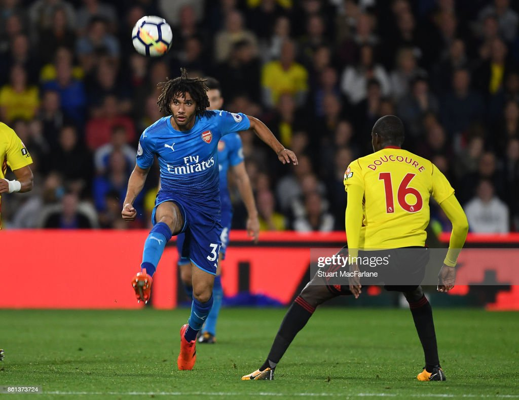 Mohamed Elneny of Arsenal takes on Abdoulaye Doucoure of Watford during the Premier League match between Watford and Arsenal at Vicarage Road on October 14, 2017 in Watford, England.