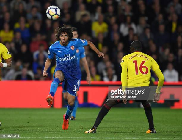 Mohamed Elneny of Arsenal takes on Abdoulaye Doucoure of Watford during the Premier League match between Watford and Arsenal at Vicarage Road on...