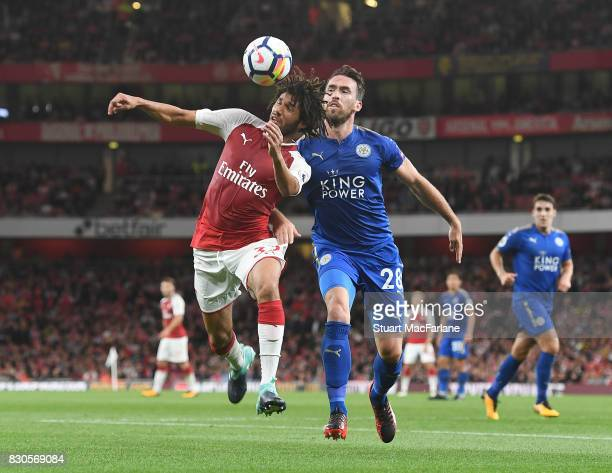 Mohamed Elneny of Arsenal takes on Christian Fuchs of Leicester during the Premier League match between Arsenal and Leicester City at Emirates...