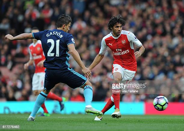 Mohamed Elneny of Arsenal takes on Gaston Ramirez of Middlesbrough during the Premier League match between Arsenal and Middlesbrough at Emirates...