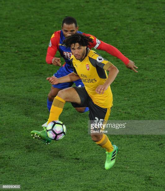 Mohamed Elneny of Arsenal takes on Jason Puncheon of Palace during the Premier League match between Crystal Palace and Arsenal at Selhurst Park on...