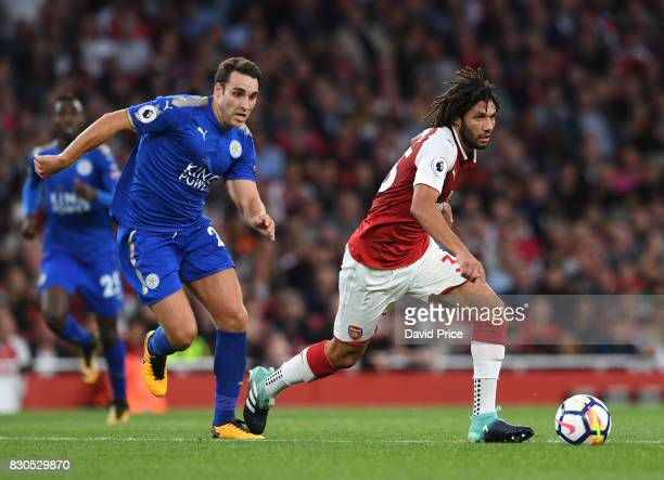 Mohamed Elneny of Arsenal takes on Matty James of Leicester during the Premier League match between Arsenal and Leicester City at Emirates Stadium on...