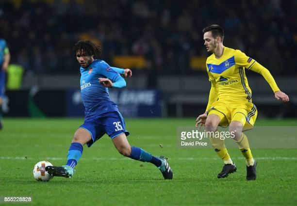 Mohamed Elneny of Arsenal turns away from Mirko Ivanic of Bate during the UEFA Europa League group H match between BATE Borisov and Arsenal FC at...