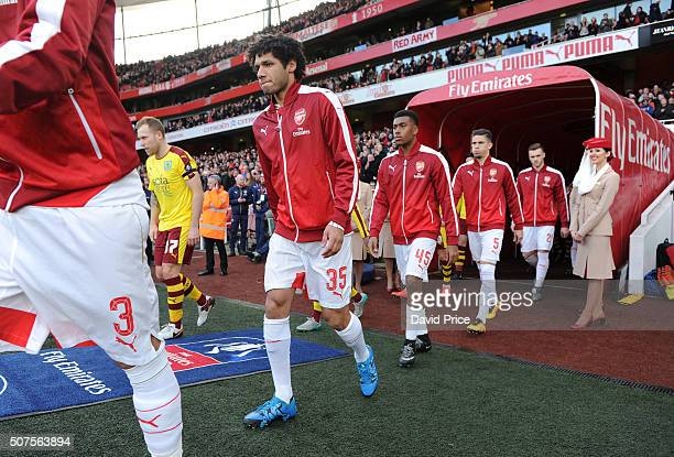 Mohamed Elneny of Arsenal walks out before the match between Arsenal and Burnley in the FA Cup 4th round at Emirates Stadium on January 30 2016 in...