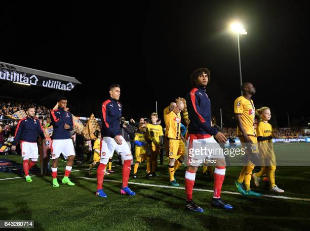 Mohamed Elneny of Arsenal walks out with his team mates before the match between Sutton United and Arsenal on February 20 2017 in Sutton Greater...
