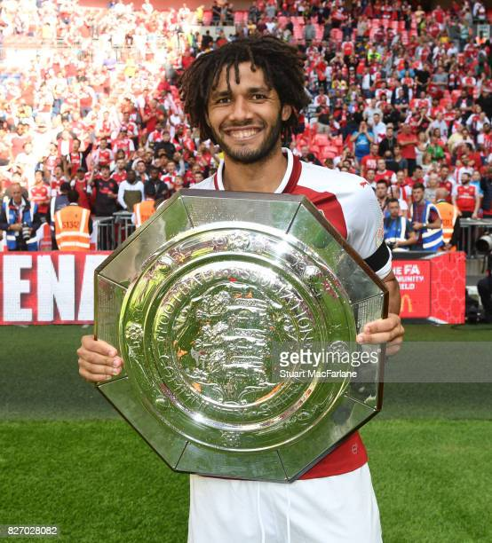 Mohamed Elneny of Arsenal with the Community shield after the FA Community Shield match between Chelsea and Arsenal at Wembley Stadium on August 6...