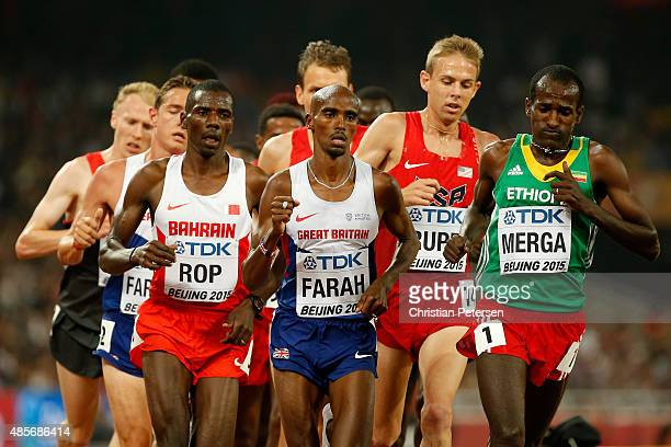 Mohamed Farah of Great Britain and Imane Merga of Ethiopia compete in the Men's 5000 metres final during day eight of the 15th IAAF World Athletics...
