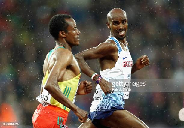 Mohamed Farah of Great Britain and Muktar Edris of Ethiopia compete in the Men's 5000 Metres heats during day six of the 16th IAAF World Athletics...