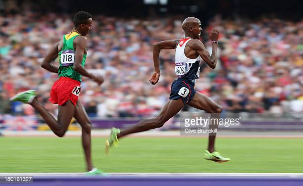 Mohamed Farah of Great Britain approaches the finish line on his way to winning gold ahead of Dejen Gebremeskel of Ethiopia as they compete in the...
