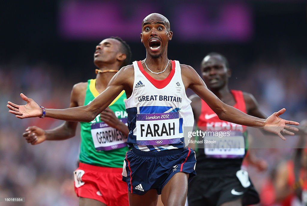 Mohamed Farah of Great Britain celebates as he crosses the finish line to win gold ahead of <a gi-track='captionPersonalityLinkClicked' href=/galleries/search?phrase=Dejen+Gebremeskel&family=editorial&specificpeople=5857672 ng-click='$event.stopPropagation()'>Dejen Gebremeskel</a> of Ethiopia and <a gi-track='captionPersonalityLinkClicked' href=/galleries/search?phrase=Thomas+Pkemei+Longosiwa&family=editorial&specificpeople=5501347 ng-click='$event.stopPropagation()'>Thomas Pkemei Longosiwa</a> of Kenya in the Men's 5000m Final on Day 15 of the London 2012 Olympic Games at Olympic Stadium on August 11, 2012 in London, England.
