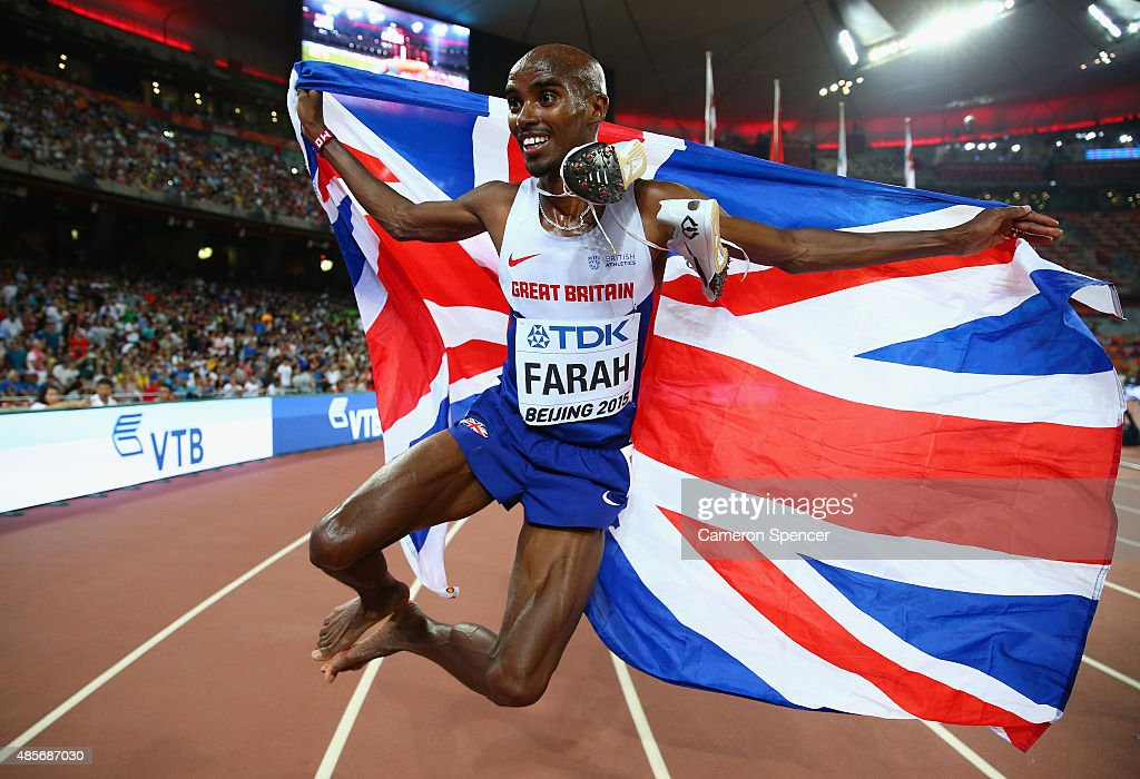 Mohamed Farah of Great Britain celebrates after crossing the finish line to win gold in the Men's 5000 metres final during day eight of the 15th IAAF World Athletics Championships Beijing 2015 at Beijing National Stadium on August 29, 2015 in Beijing, China.