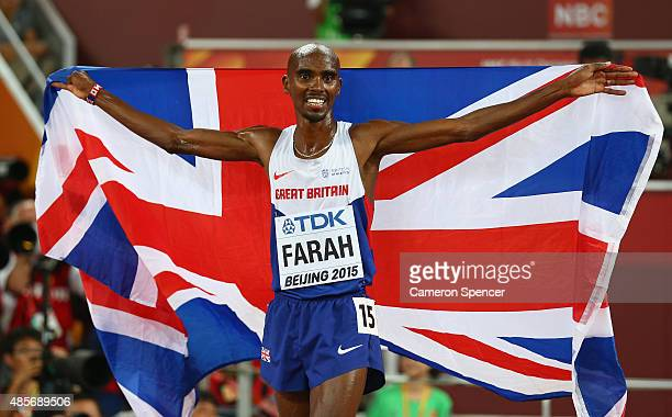 Mohamed Farah of Great Britain celebrates after crossing the finish line to win gold in the Men's 5000 metres final during day eight of the 15th IAAF...