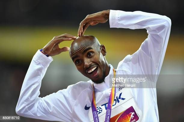 Mohamed Farah of Great Britain celebartes on the podium by doing the 'mobot' after being presented with his silver medal after finishing second in...