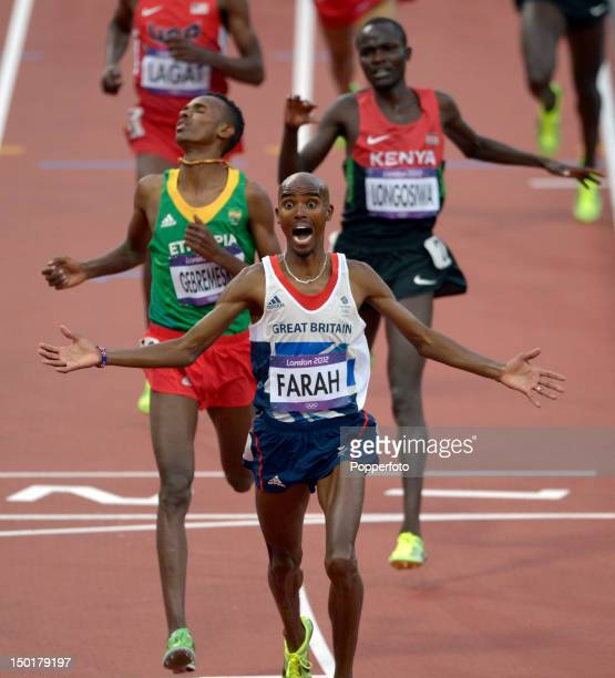 Mohamed Farah of Great Britain celebrates victory in the Men's 5000m Final on Day 15 of the London 2012 Olympic Games at Olympic Stadium on August 11...