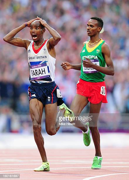 Mohamed Farah of Great Britain celebrates wining gold ahead of Dejen Gebremeskel of Ethiopia in the Men's 5000m Final on Day 15 of the London 2012...