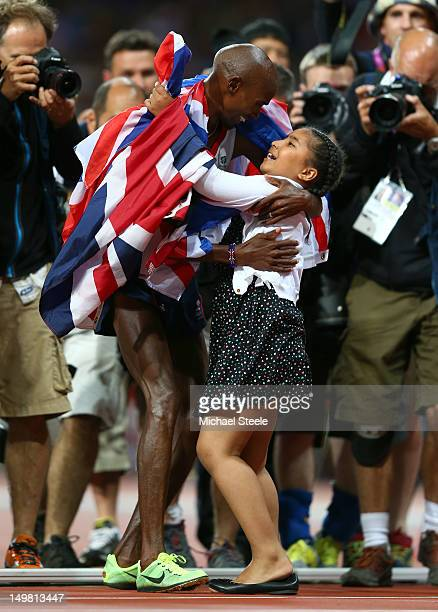 Mohamed Farah of Great Britain celebrates winning gold in Men's 10000m Final with his daughter Rihanna Farah on Day 8 of the London 2012 Olympic...