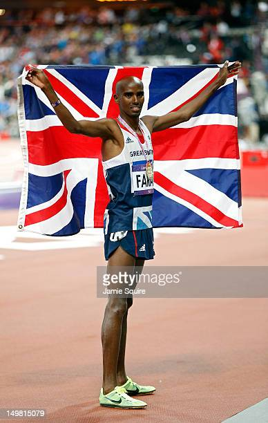 Mohamed Farah of Great Britain celebrates winning gold in the Men's 10000m Final on Day 8 of the London 2012 Olympic Games at Olympic Stadium on...
