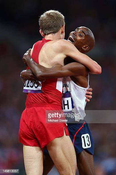 Mohamed Farah of Great Britain celebrates winning the gold medal in Men's 10000m Final with Galen Rupp of the United States on Day 8 of the London...