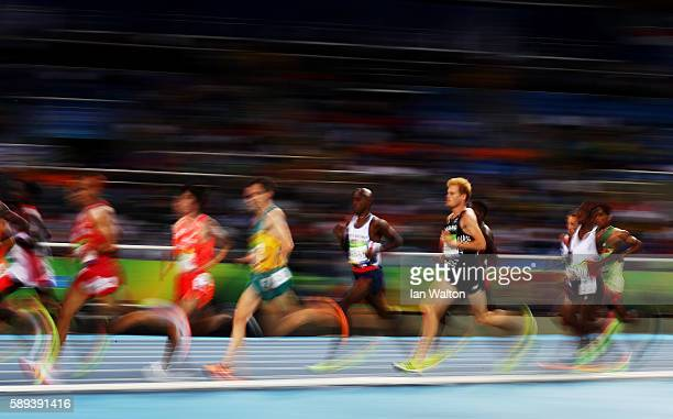 Mohamed Farah of Great Britain competes during the Men's 10000m on Day 8 of the Rio 2016 Olympic Games at the Olympic Stadium on August 13 2016 in...