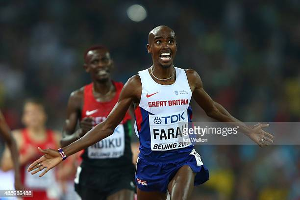 Mohamed Farah of Great Britain crosses the finish line to win gold in the Men's 5000 metres final during day eight of the 15th IAAF World Athletics...
