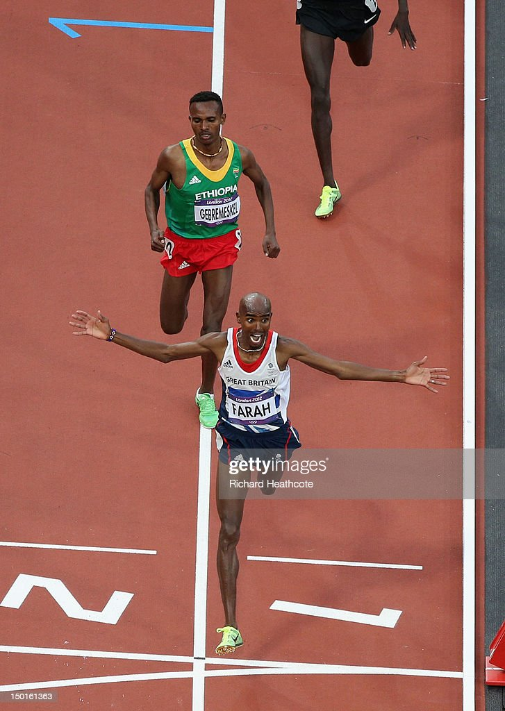 Mohamed Farah of Great Britain crosses the finish line to win gold ahead of Dejen Gebremeskel of Ethiopia in the Men's 5000m Final on Day 15 of the London 2012 Olympic Games at Olympic Stadium on August 11, 2012 in London, England.