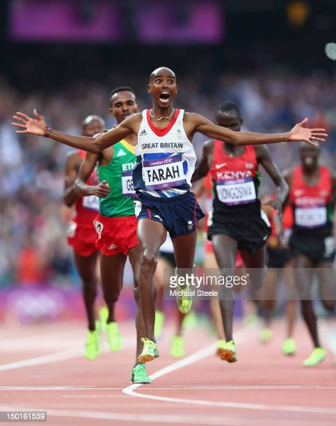 Mohamed Farah of Great Britain crosses the finish line to win gold ahead of Dejen Gebremeskel of Ethiopia and Thomas Pkemei Longosiwa of Kenya in the...
